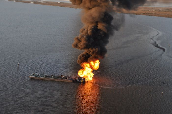 Dangers of Transporting Fossil Fuels: A pipeline burns after an allision with tug boat Shanon E. Setton, near Bayou Perot 30 miles south of New Orleans, March 13, 2013. The Coast Guard is working with federal, state and local agencies in response to this incident to ensure the safety of responders and contain and clean up any oil that is leaking. (U.S. Coast Guard photo courtesy of Coast Guard Air Station New Orleans)