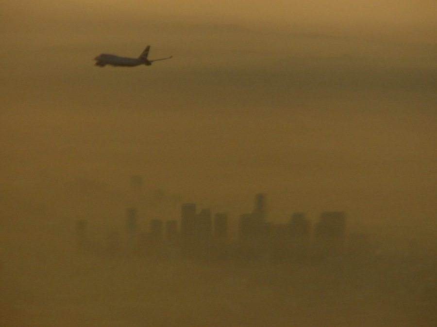 Smog continues as the principal threat to air quality. The Los Angeles Skyline approaching LAX