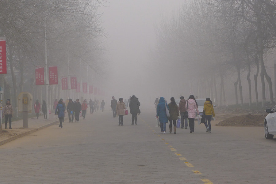 University students at Anyang Normal University, Christmas Day, 2013, Henan Province, China. Cognitive impacts air pollution.