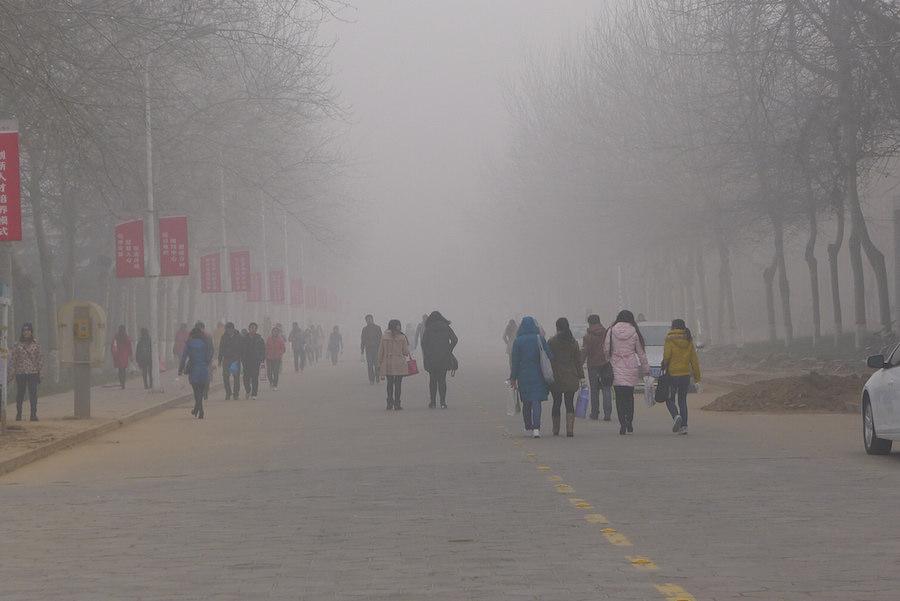 University students at Anyang Normal University, Christmas Day, 2013, Henan Province, China. Cognitive impacts air pollution.