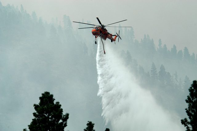 A helicopter fighting yet another raging wildfire