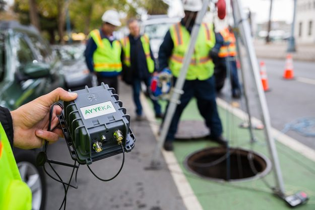 Installing sensors to monitor sewer lines underneath the streets of San Francisco